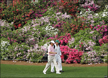 Canada's Stephen Ames walks down the sixth fairway with his caddie Dean Elliot