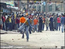 Kashmiri protesters throw stones at policemen during a protest in Srinagar