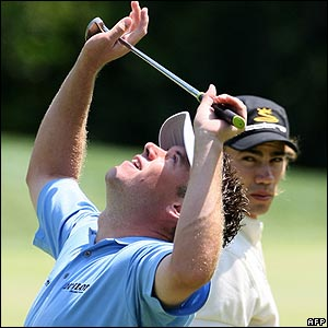Lee Westwood is watched by Colombias Camilo Villegas 