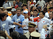Zhang Hao from China carries the Olympic flame in Buenos Aires 11 April
