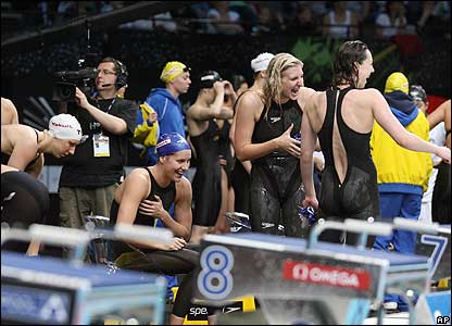 Women's freestyle relay teams share a joke