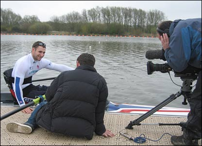 Rower Tom Aggar is interviewed by a BBC Television crew