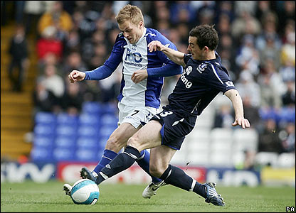 Birmingham City's Sebastian Larsson is challenged by Leighton Baines
