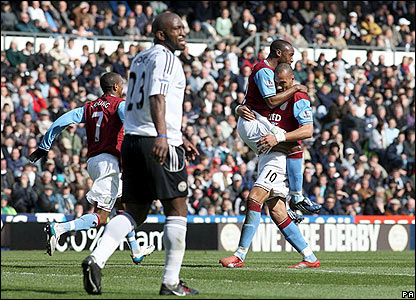 John Carew celebrates scoring for Derby