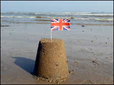 Sand castle with British flag