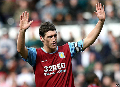 Villa's Gareth Barry celebrates scoring his side's fourth goal