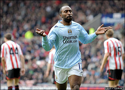 Darius Vassell celebrates scoring the winner for Man City