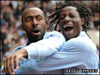 Darius Vassell and Benjani celebrate Manchester City's winner