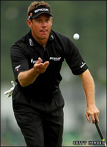 Lee Westwood throws his ball