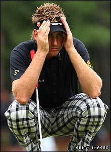 Ian Poulter eyes up a putt