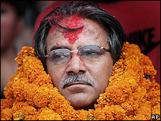 Maoist leader Prachanda wears flower garlands after his poll victory (12.04.08)