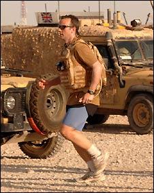 Major Al Jarvis running in Afganistan wearing his Osprey body armour