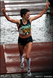 Irina Mikitenko of Germany crosses the line to win the women's event