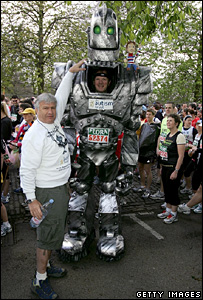 Charity fundraiser Lloyd Scott dressed as a robot prepares for the London Marathon