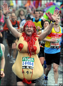 Runner in a 'fake breasts' costume