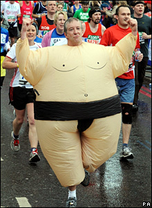 Man in an inflatable sumo wrestler outfit