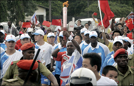 The Olympic Torch is carried through Dar es Salaam