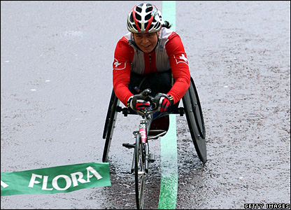 "Sandra Graf of Switzerland crosses the line to win the women""s wheelchair event"