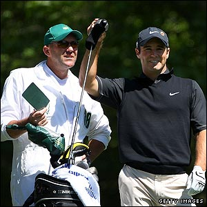 Trevor Immelman consults with his caddy