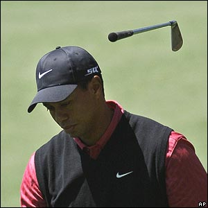 Tiger Woods throw away his club