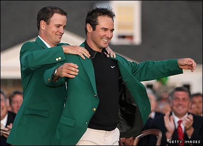 Zach Johnson (left) puts the Green Jacket on Trevor Immelman