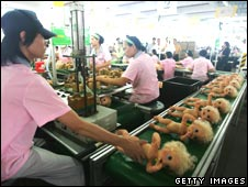 Dolls on a factory line in China
