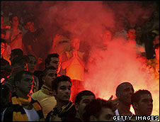 Beitar Jersualem fans burn flares at a match in October 2006