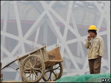 Worker at the Olympic Stadium in Beijing, 06/04