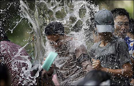 Thais celebrate their New Year with a water fight in Bangkok.