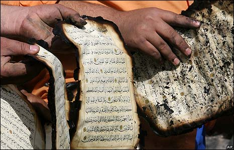 Iraqis recover charred pages of the Koran in Baghdad