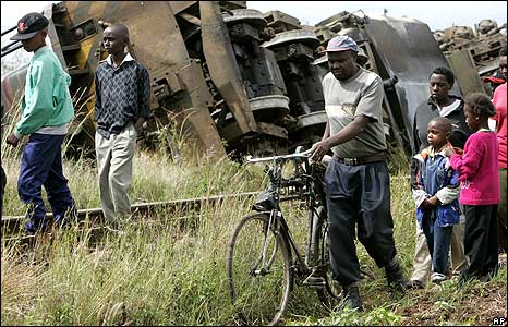 Kenyans pass a train derailed in Nairobi