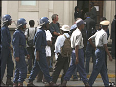 Police monitor the situation at the High Court in Harare on Monday 14 April 2008
