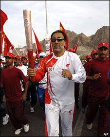 Sayyd Shehab bin Tariq, a consultant of Oman's leader Sultan Qaboos, carries the Olympic torch in Muscat, Oman, 14 April, 2008