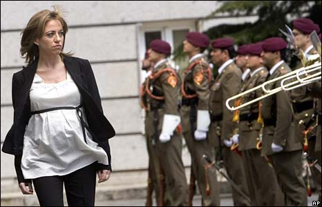 Carme Chacon walking past the troops.  (She is expecting her second child in two months.)