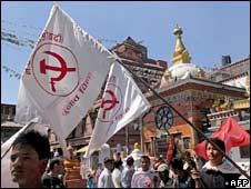 Supporters of the Communist Party of Nepal (Maoist) with Communist flags