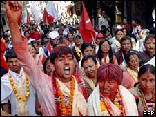 Supporters of the Communist Party of Nepal (Maoist) chant slogans during a rally