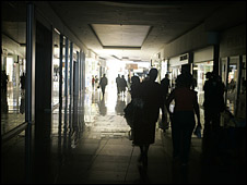 The Star newspaper captures shoppers at Jabulani Mall in Soweto, south of Johannesburg during a blackout