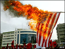 Demonstrators burn a US flag during a rally against the Iraq war in Istanbul, Turkey, 15 March, 2008