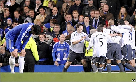 Chelsea's Michael Ballack (left) struggles to come to terms with Wigan's late equaliser