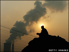 File photo of a man squatting near a power plant in Beijing, October 2007