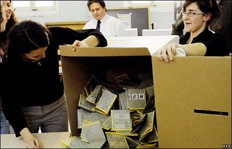 Italy's electoral commission workers empty a ballot box before counting at a polling station in Rome, 14 April, 2008
