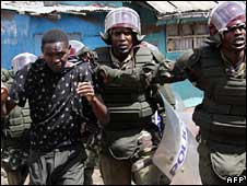 Police detain a suspect during disturbances in the Dandora district of Nairobi, 14 April