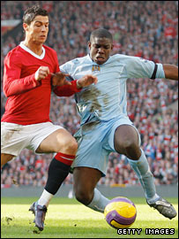 Micah Richards tackles Ronaldo during the Manchester derby in February