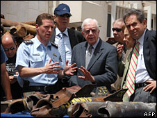 Israeli officials show Jimmy Carter the remains of rockets fired from the Gaza Strip into Israel, 14 April 2008