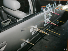 Arrows show the trajectory of the bullets which hit Mr Bell's car