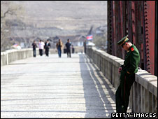 A Chinese soldier guards a bridge in Jilin province on the border with North Korea on 8 April 2008