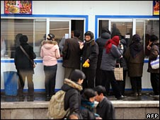 North Koreans queue for food at a kiosk in Pyongyang on 26 February 2008