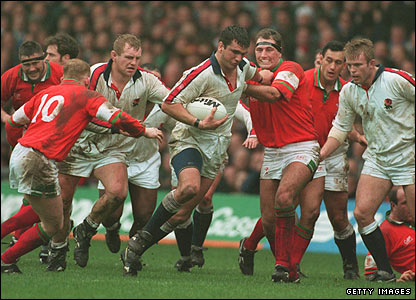 Martin Johnson storms through the Welsh defence during the Five Nations match at Cardiff Arms Park in February 1995