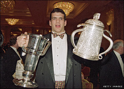 Martin Johnson holds the Five Nations Trophy and the Calcutta Cup at a function to celebrate England's Grand Slam in 1995