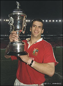 Lions captain Johnson holds aloft the trophy after winning the three-match series against South Africa